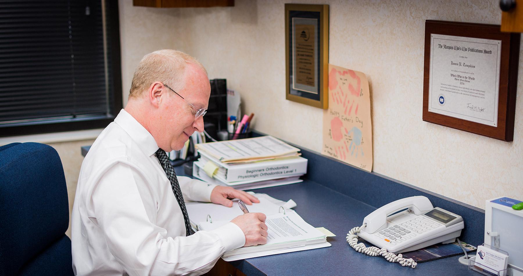 Dr. Tompkins at his desk